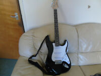Full Full size electric guitar with 20watt amp and accessories. New condition