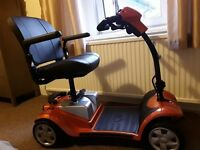 Kymco Mobility Boot Scooter in Flame Orange only used 3 times. 16 mile range
