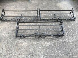 Wrought iron under window flower tub holders