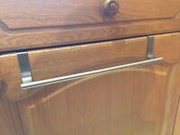 Towel rail for kitchen cupboard door