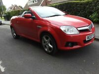 Red 2007 Tigra convertible for sale in s cambs area. Roof retracts automatically. Low mileage