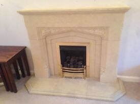 Coal effect gas fire with surround and hearth