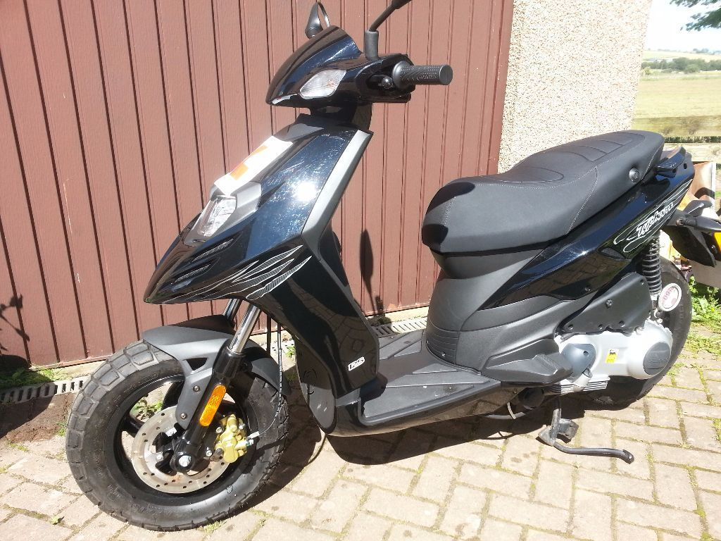 piaggio typhoon 125 for sale. black, '63 plate, less than 300