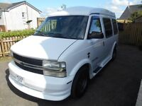 GMC astrovan camper complete with awning