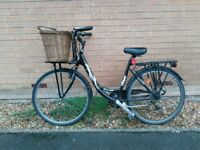 Dutch style bike with removable basket and wooden pannier rack