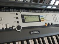 Yamaha EZ-200 Electric Keyboard with stand and book