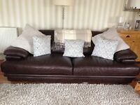 Three seater chocolate brown sofa in excellent condition