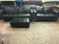 Like new stud black 2 and 3 seater with footstool