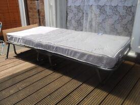 single spring sprung fold up bed