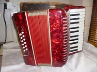 red accordion with case