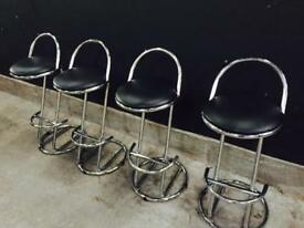 Four leather and chrome bar/ island stools