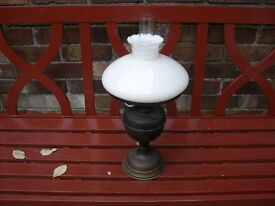 An oil lamp complete with glass opaque shade.