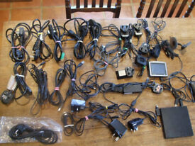 Assortment of chargers/power leads and older version satnav