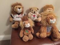 Assorted commemorative football and rugby soft toys.
