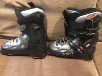 Three pairs ski boots.
