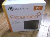 Seagate Expansion 2TB Desktop External Hard Drive - Unopened and in sealed box with security seal.
