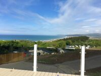 Luxury 3 bedroom lodge with huge decking,stunning views, 12 month holiday season in west Wales