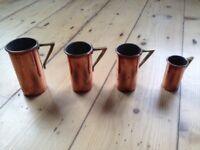Set of vintage copper measuring cups
