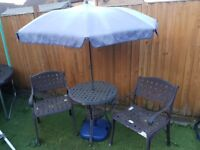 Bistro garden table with chairs and parasol.