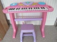 Pink toy keyboard with microphone and stool in excellent condition and full working order