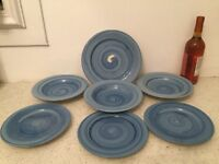 Blue pottery bowls, side plates and large plate.