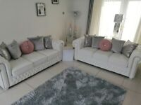 2x white leather chestrfield sofas 1 has never been sat on other is as new