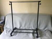 EXCELLENT CONDITION! Height adjustable portable/temporary hanging clothes rail.