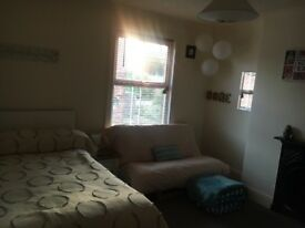 Large room for short term rent, furnished, small double, futon, tv, dressing table