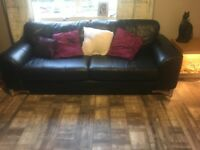 Black leather sofa brill condition