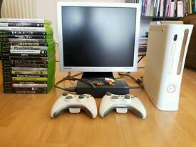 Xbox 360 with games and monitor