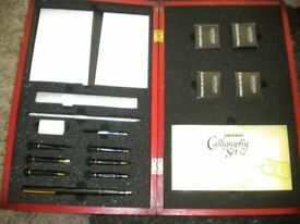 A PARTNERS CALLIGRAPHY SET UNUSED IN WOOD CASE