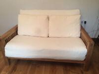 Two seat solid oak futon by Futon Company, 'OKE' range with three fold mattress, pillows an cover
