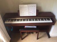 Yamaha Clavinova CLP220M digital piano and piano stool