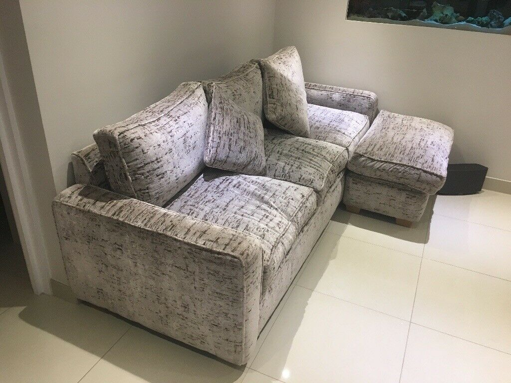 Luxury 3 seater sofa with foot stool .Oyster colour with brown flecks . Immaculate condition