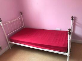 White metal single bed frame and matress