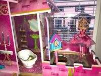 Doll house and barbie dolls