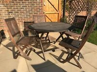 Solid teak table and 4 chairs