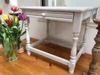 Small oak coffee table with a draw painted in light grey.