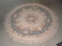 Circular all wool rug fringed, in blue and cream. 120cm diam. excluding fringe. Good condition