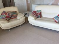 Two seater sofa armchair and swivel chair and foot stool excellent condition 18 months old