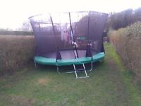 a brand new 12 ft trampoline never used before with all its parts. safety net not included.