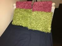 Green and pink B&Q pillows