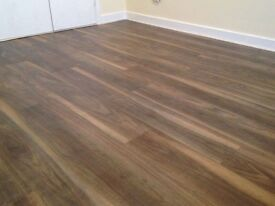7mm Laminate flooring 20m2 £275 fully fitted with underlay beading delivery door bar!