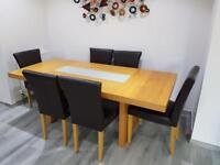 Solid oak dining table and 6 real leather chairs