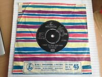 "The Beatles 'I Want To Hold Your Hand/This Boy' 7"" Vinyl. (R-5084/1963/Parlophone Records)."