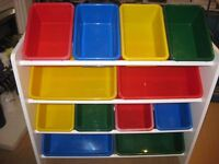 Childs storage unit with coloured plastic boxes. White wood frame with teddys on side.