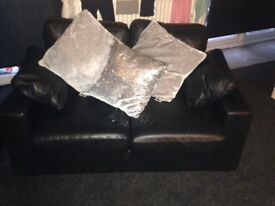 Two seater leather sofas x2