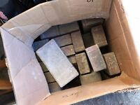 Box of standard shape/size bricks that were used for a fireplace hearth