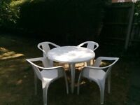 White plastic garden table and 4 chairs