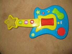 Toy guitar with music and lights